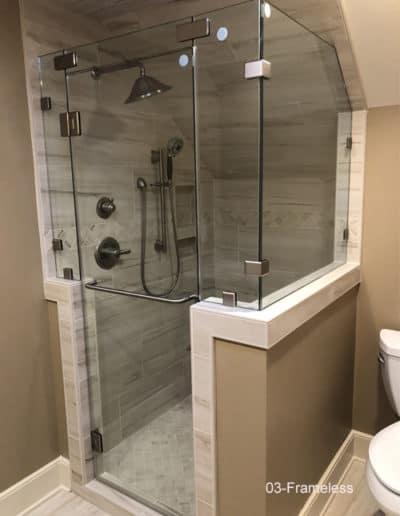 Small frameless shower enclosure
