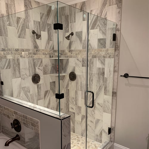 Glass shower doors have other advantages over shower curtains. Curtains can easily shift, and depending on conditions may even try to suck into the shower and cling to you.