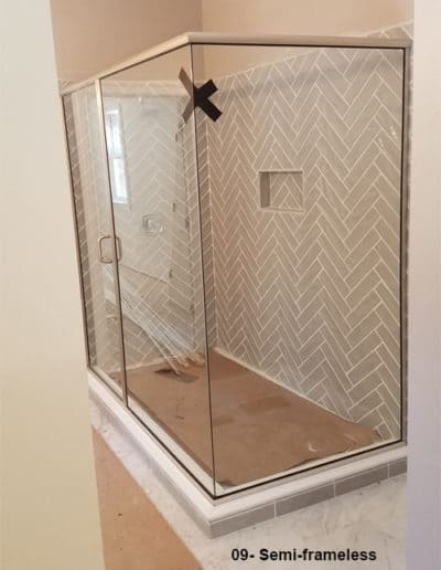 Semi framed glass brushed shower